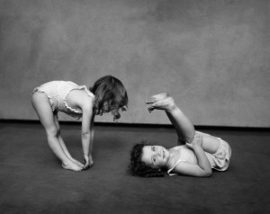 1930s Two Girls Wearing Underclothes Playing At Exercising